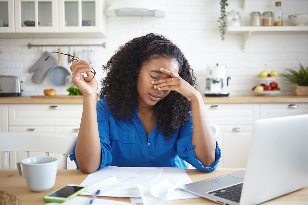 Woman stressed out working from home